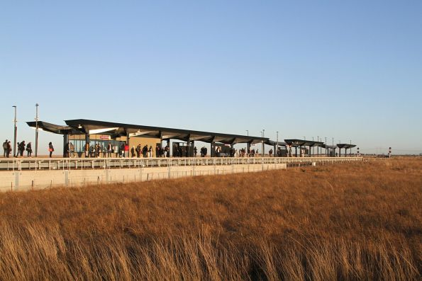Passengers waiting out on the open plains at Caroline Springs station