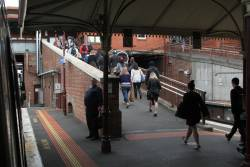 Passengers exit a direct to Flinders Street service at North Melbourne