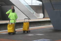 Posties catching the train from North Melbourne station