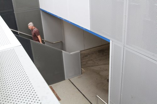 Steps and ramp down to the pedestrian subway at Southland station
