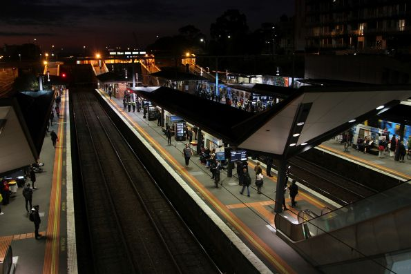 Night falls at North Melbourne station