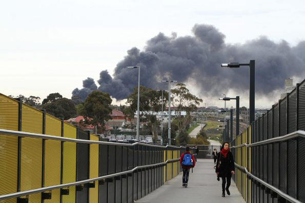 Smoke clouds over Sunshine station from the factory fire in West Footscray