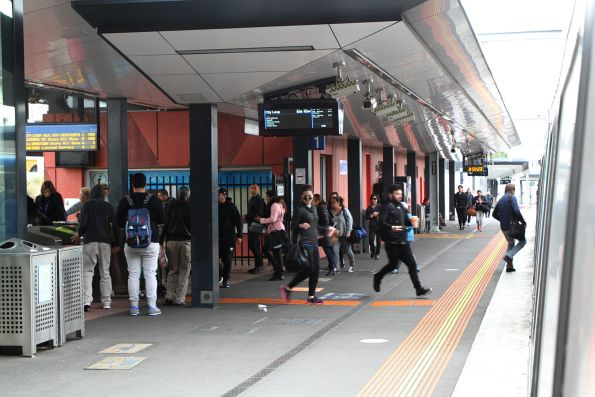 Passengers run for a City Loop service at Footscray platform 1