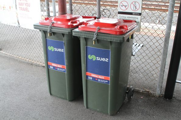 Locked up rubbish bins at the entrance the Middle Footscray station