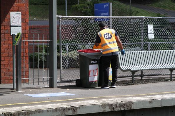 Cleaner checking up on the rubbish bins at Eaglemont station