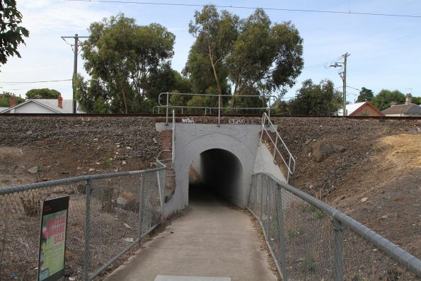 Pedestrian underpass routed via a drainage culvert at the down end of Fairfield station