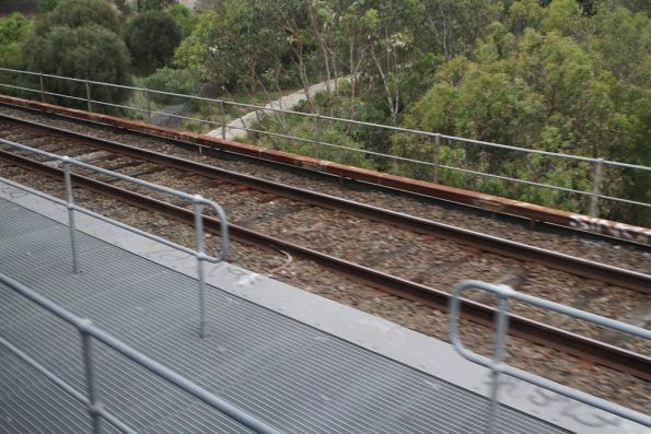 Steel mesh deck between the two single track bridges over Merri Creek on the Hurstbridge line