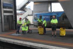 Australia Post posties waiting for a train at North Melbourne station