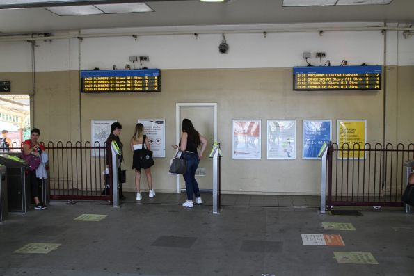 Overflow myki readers and two sets of 4 line LED next train displays at the main entrance to South Yarra station