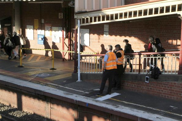 Metro Trains staff on crowd control duties at South Yarra platform 6