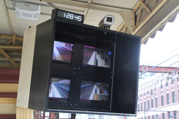SPOT monitor and digital clock at the west end of Flinders Street platform 4