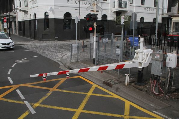 Separate boom barrier and flashing lights at the Greville Street level crossing in Prahran