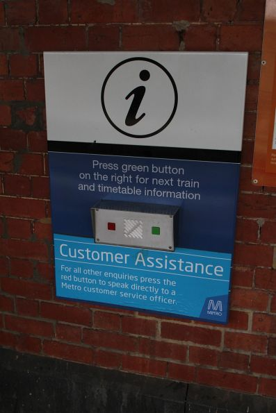 Customer assistance trial signage still in place on the emergency button at Ascot Vale station