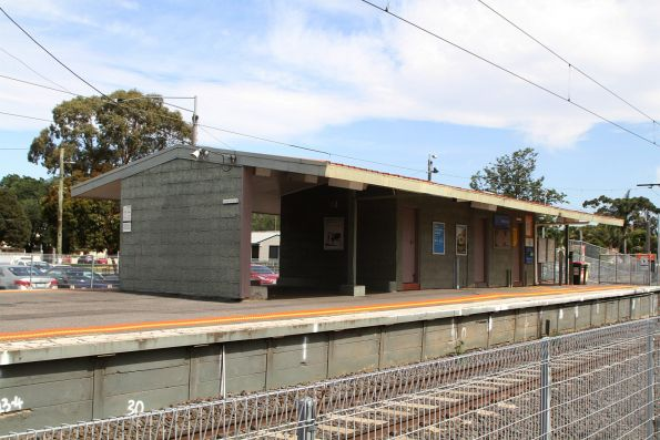 Pebblecrete station building on the island platform at Merlynston