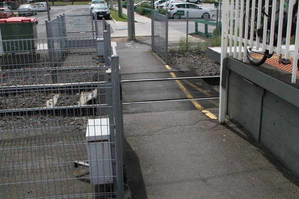 Pedestrian crossing hard up against the station platform at Gowrie station