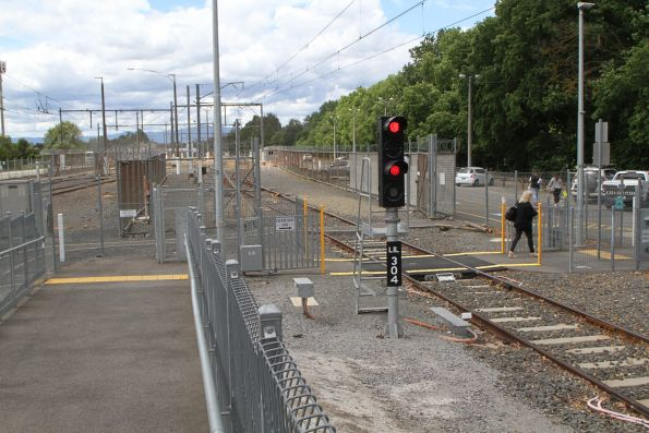 Signal LIL304 protects the pedestrian crossing at the down end of Lilydale platform 1