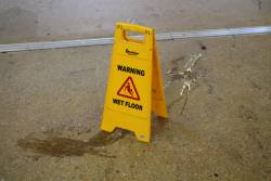 'Caution wet floor' sign on the station concourse following a spill