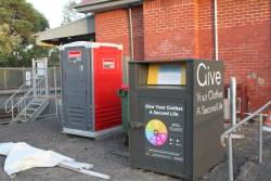 Clothing recycling bin and a portaloo outside Rushall platform 2