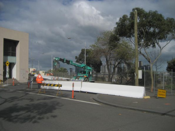 Placing concrete crash barriers around the future worksite at North Melbourne station