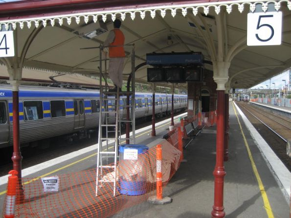 Painting awnings at North Melbourne station