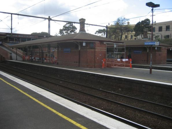 Repainting the station buildings at North Melbourne