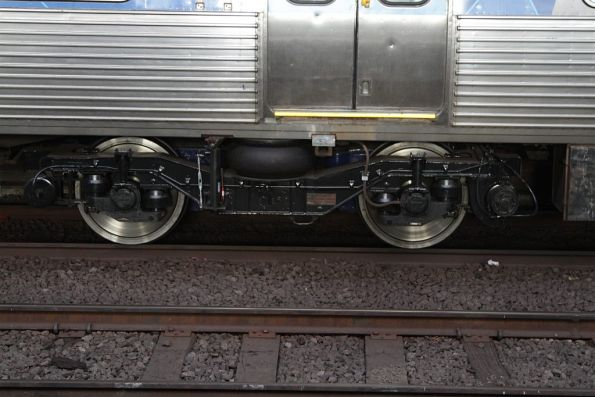 Freshly refurbished bogies on a disk braked Comeng train