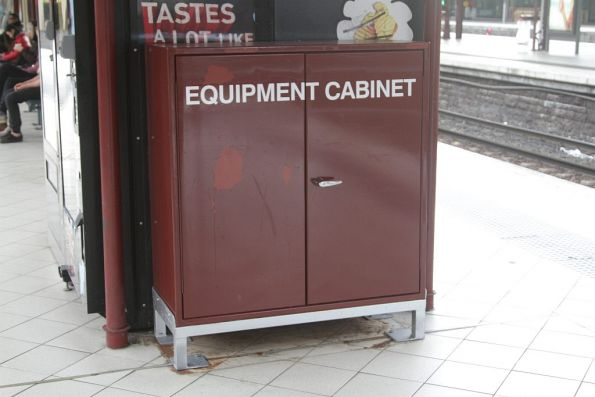 Equipment cabinet on the platform at Flinders Street Station, used to hold temporary window and other parts for damaged trains