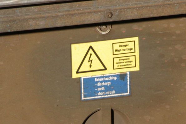 'Danger high voltage' warning on an Siemens train equipment cabinet housing capacitors