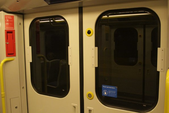 New anti-vandalism guards fitted to the windows seals of a Siemens train door