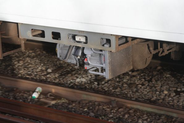 Freshly refurbished compressor beneath an X'Trapolis train