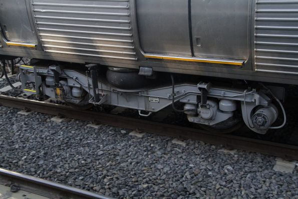 New build Alstom bogie beneath a disc braked Comeng train