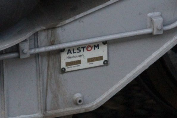 'Alstom Neuhausen' builders plate on a new bogie beneath a disc braked Comeng train