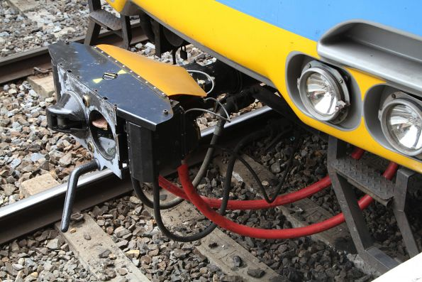 Freshly refurbished scharfenberg coupler on the front of an Alstom Comeng train