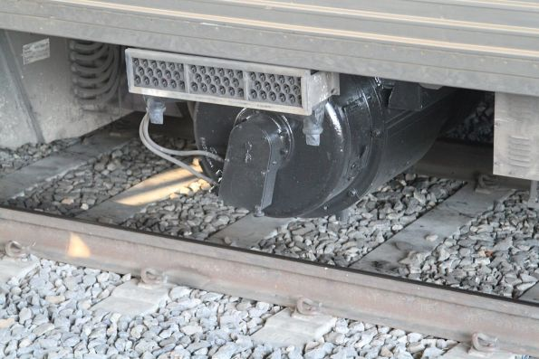 Motor alternator beneath a tread braked Comeng train