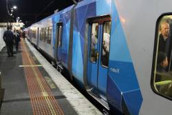 Forgotten Metlink logo on the side of an X'Trapolis train