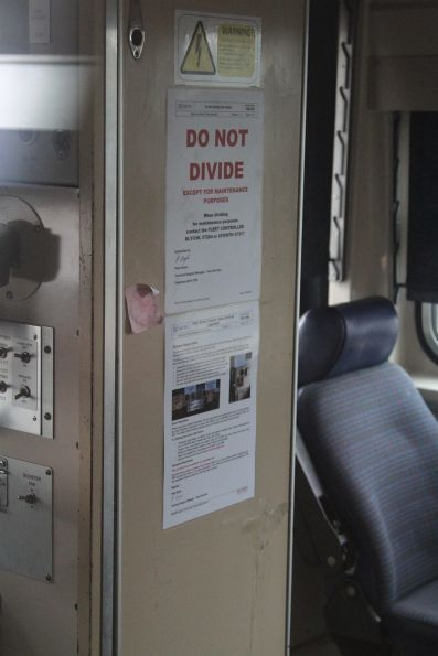 'Do not divide' notice in the cab of Comeng 434M