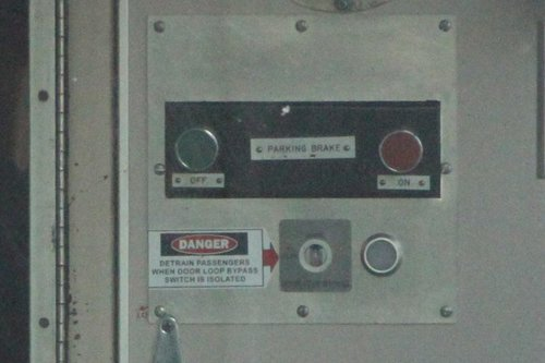 'Detrain passengers when door loop bypass switch is isolated' notice onboard a Comeng train