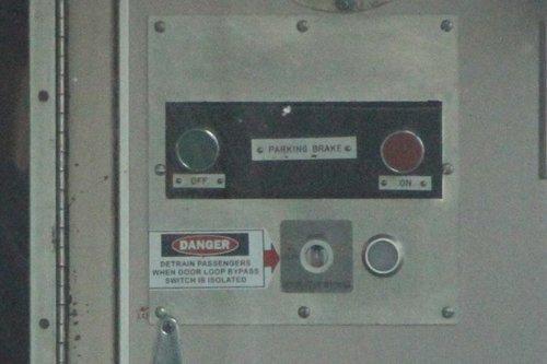 'Detrain passengers when door loop bypass switch is isolated' notice onboard a Comeng train