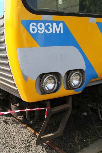 Filled in front step of Alstom Comeng 693M