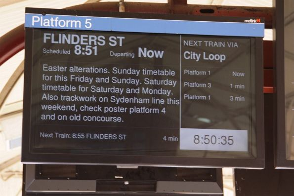 Screens at North Melbourne advising passengers of timetable alterations over Easter