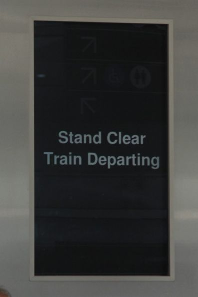 Recently added 'stand clear / train departing' message on the screens at Flinders Street Station