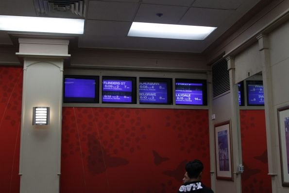 Next train displays inside the McDonalds dining room at Box Hill