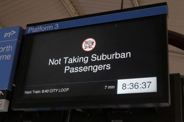 'Not taking suburban passengers' notice on the screens at North Melbourne platform 3
