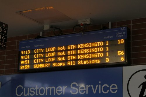 Watergardens station displays the next three up services, and the down service