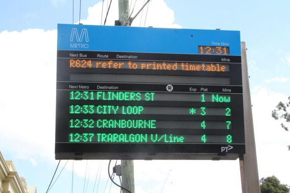 Metro branded display outside Caulfield station, showing next bus and train departures