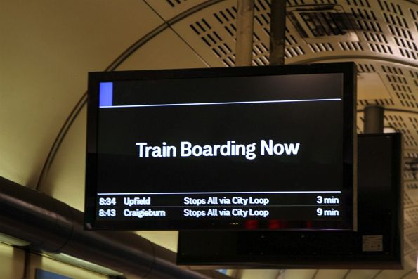 'Train Boarding Now' message on the PIDS at Flagstaff station