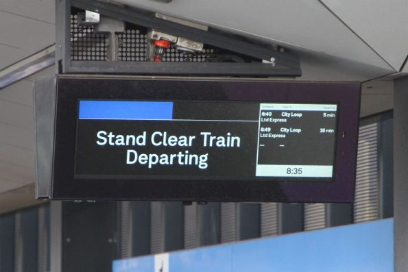 'Stand clear train departing' burn line on the PIDS at Sunshine station