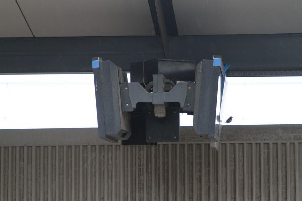 Old format LCD panel mounting brackets on the platform at North Melbourne