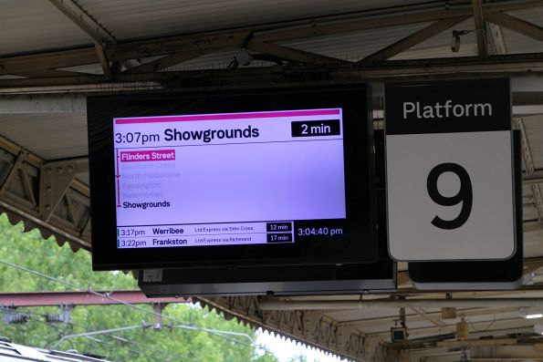 Showgrounds service on the next train displays at Flinders Street platform 9