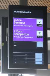 'V/Line services line' screen in purple on the main concourse at North Melbourne